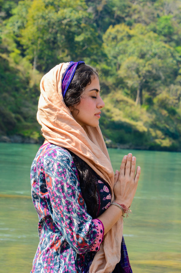 Yoga retreat in India Meditation by the Ganges river